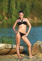 Busty Paris takes off her black bikini on the beach
