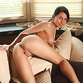Busty petite brunette Devi spreads her pussy