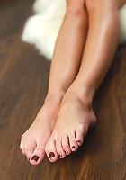 Skinny petite and naked rabbit girl spreading her legs
